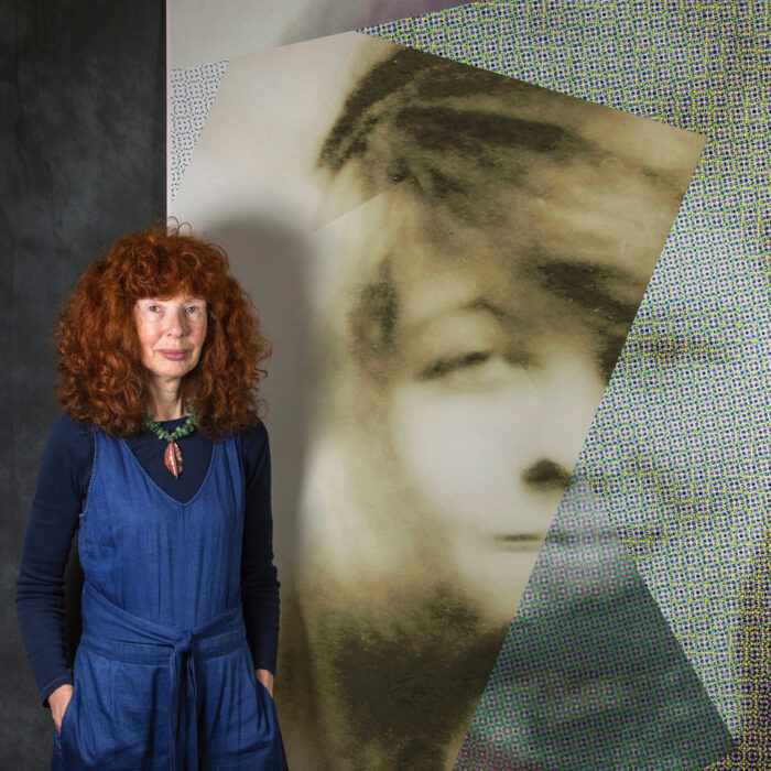 Shows photographer Julia Cameron with her work